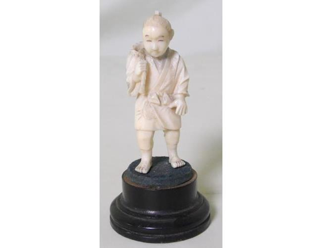 Antique Japanese Carved Ivory Figure of a Boy  with Basket on Turned Stand.