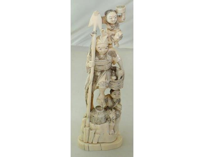 Antique Oriental Carved Ivory Sculpture of a  Fisherman