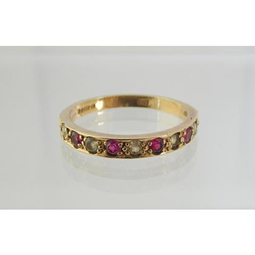 9ct Yellow Gold Ladies dress Ring Mounted  with 4 Rubies