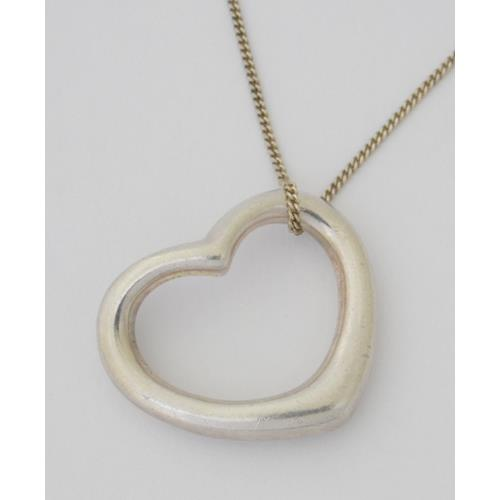Sterling Silver Floating Heart Pendant on 18  inch Silver Chain.