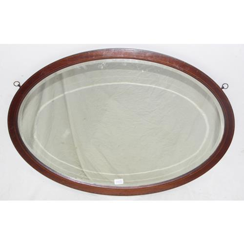 Edwardian Oval Inlaid Mahogany Wall Mirror  with Bevelled Lense. Early 1900s.